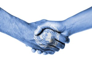 Man and woman shaking hands, isolated on white, United Nations
