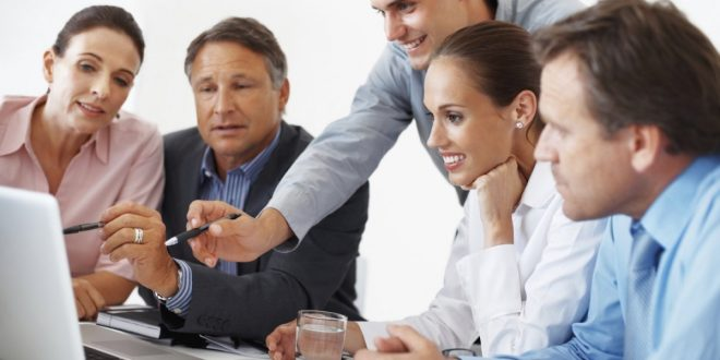 business-people-working-together-istock